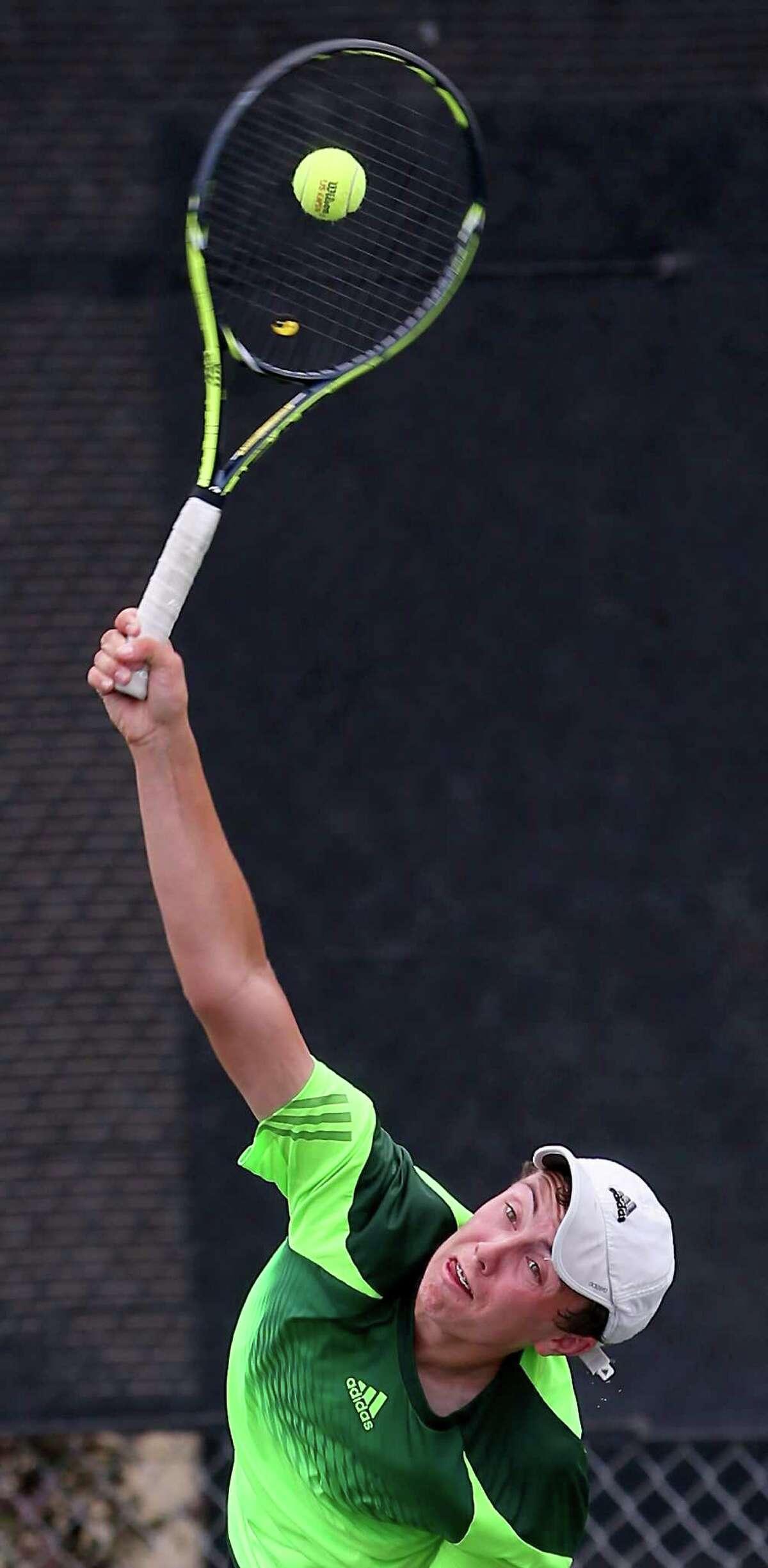 Reagan's Eddie Ayers competes April 22, 2015 at the McFarland Tennis Center in the Region IV-6A tennis tournament against Gabriel Burundi. Ayers won 6-1, 7-6 (1).