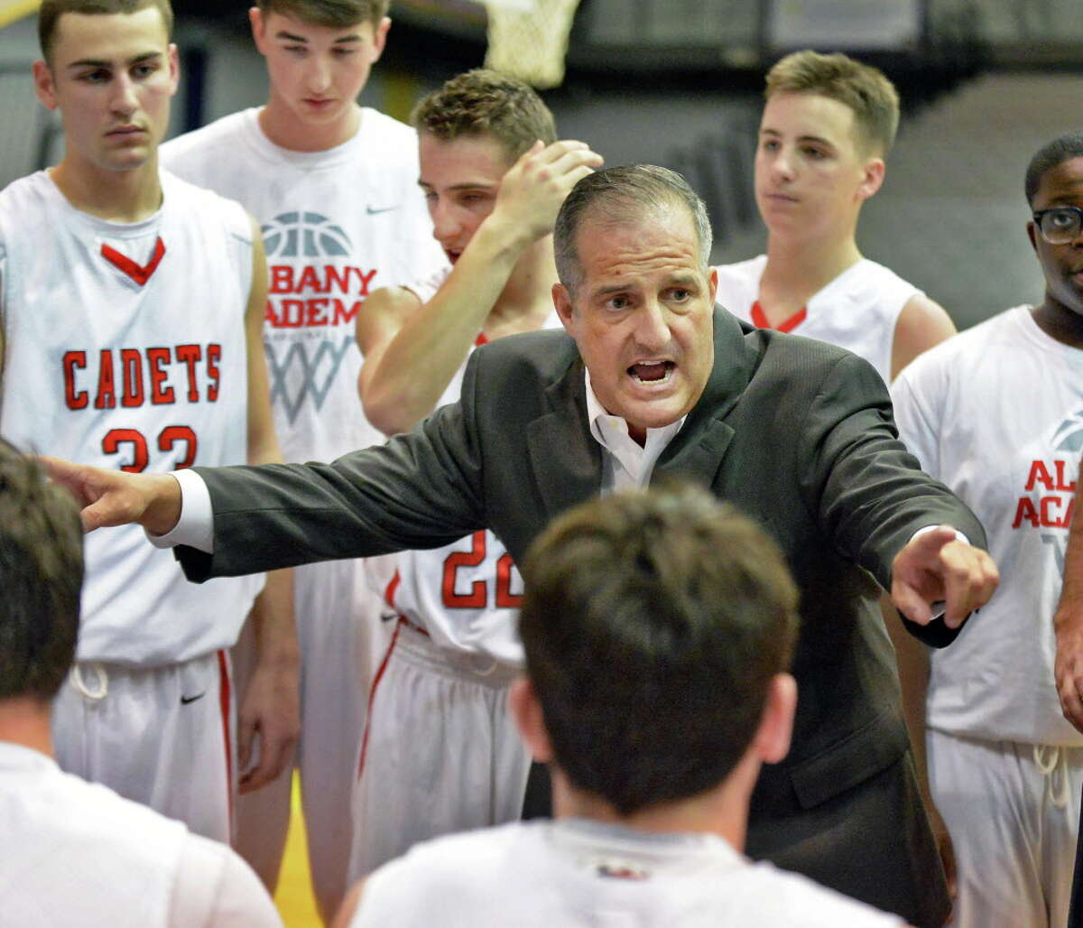 Albany Academy head coach Brian Fruscio with players during a time out in the Class A Boys' Federation Tournament final against Canisius at the SEFCU Arena Saturday March 28, 2015 in Albany, NY. (John Carl D'Annibale / Times Union)