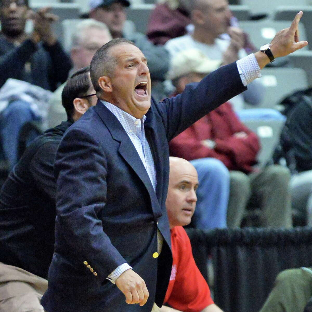 Albany Academy head coach Brian Fruscio calls out to players during their Class A Federation Tournament Semifinal against Springfield Gardens at SEFCU Arena Friday March 27, 2015 in Albany, NY. (John Carl D'Annibale / Times Union)