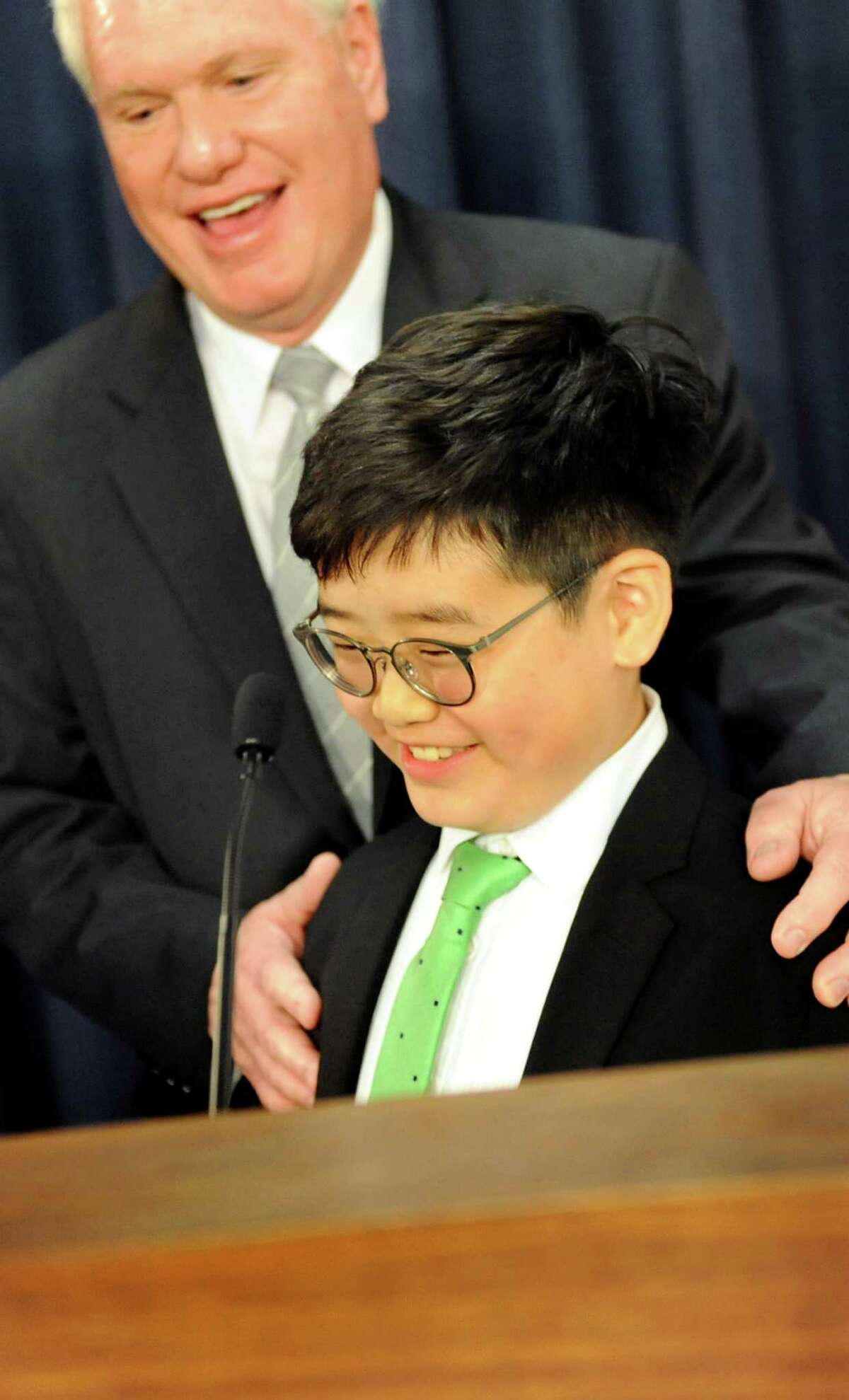 Eliot Seol , 10, of Queens takes the podium to talk about the Battery Recycling Bill at the insistence of Sen. Tony Avella on Wednesday, April 22, 2015, at the Capitol in Albany, N.Y. (Cindy Schultz / Times Union)