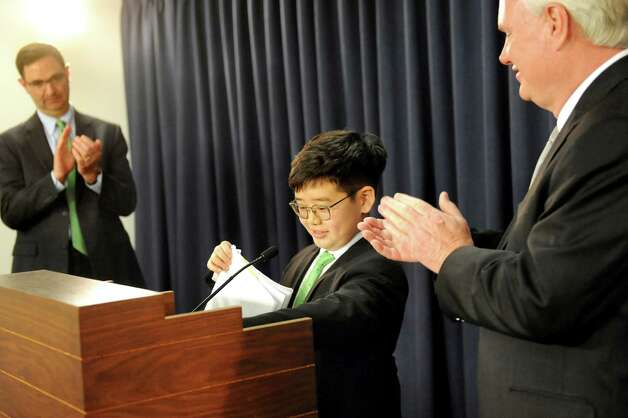 Eliot Seol , 10, of Queens, center, wraps up his comments about the Battery Recycling Bill to the applause of Peter M. Iwanowicz of Environmental Advocates, left, and Sen. Tony Avella during a news conference on Wednesday, April 22, 2015, at the Capitol in Albany, N.Y. (Cindy Schultz / Times Union) Photo: Cindy Schultz / 00031563A