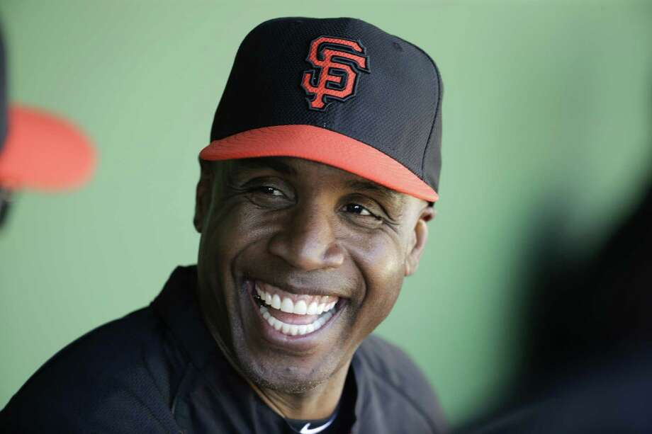 Former San Francisco Giant Barry Bonds chats to the dugout during a spring training baseball game in Scottsdale, Ariz. Bonds' obstruction of justice conviction reversed by 9th US Circuit Court of Appeals on Wednesday, April 22, 2015. (AP Photo/Chris Carlson, File) Photo: Chris Carlson /Associated Press / AP