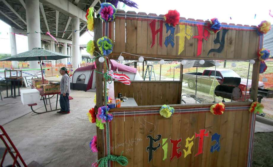 Robert Trevino,, seen Wednesday April 22, 2015, along with his wife Socarro has been hosting his friends and family for the Fiesta parades from under the I-35 overpass since the 1970s. Photo: William Luther, Staff / San Antonio Express-News / © 2015 San Antonio Express-News