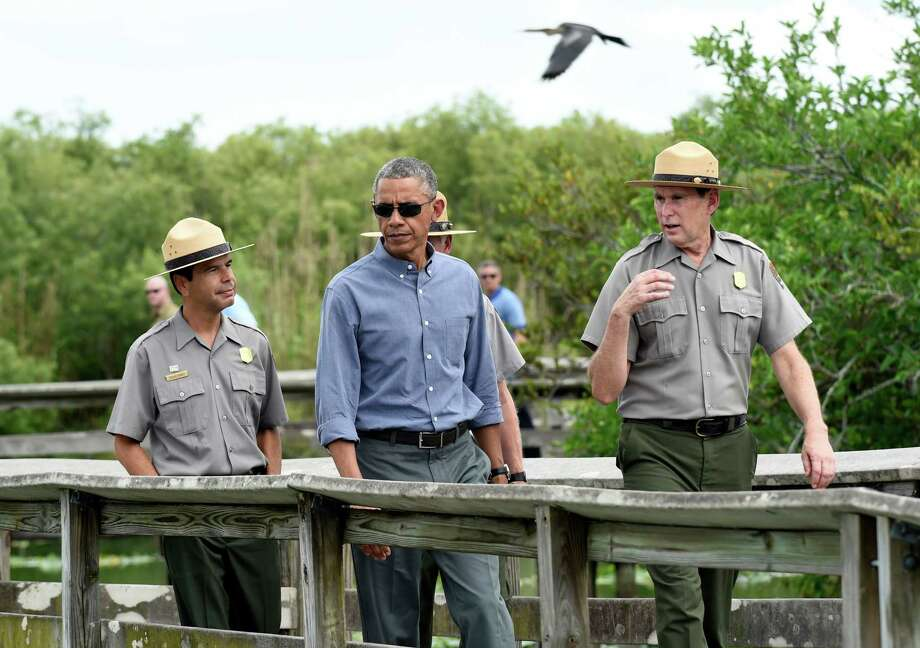 President Barack Obama walks in Everglades National Park in Florida, where he called for action against the effects of climate change. Photo: Susan Walsh /Associated Press / AP