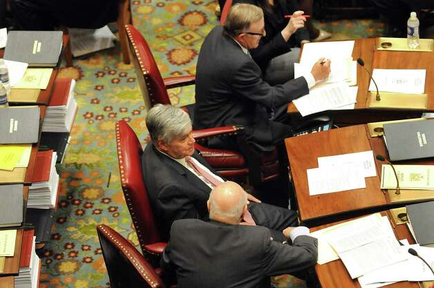 Senate Majority Leader Dean Skelos, center, on the Senate Floor on Wednesday, April 22, 2015, at the Capitol in Albany, N.Y. (Cindy Schultz / Times Union) Photo: Cindy Schultz / 00031571A