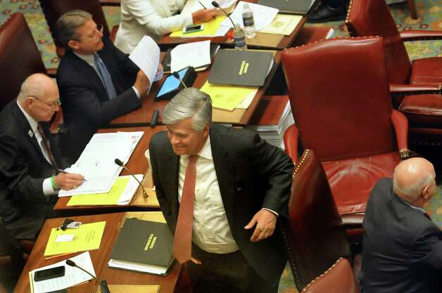 Senate Majority Leader Dean Skelos, center, leaves the Senate Chamber on Wednesday, April 22, 2015, at the Capitol in Albany, N.Y. (Cindy Schultz / Times Union) Photo: Cindy Schultz / 00031571A
