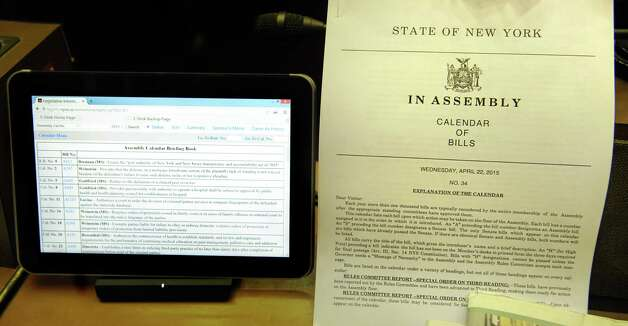 The old and the new method of providing the calendar of bills to the Assembly Chamber on Wednesday, April 22, 2015, at the Capitol in Albany, N.Y. (Cindy Schultz / Times Union) Photo: Cindy Schultz / 00031574A