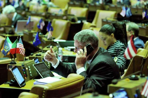 Assemblyman John T. McDonald III solves a problem with the new tablet via the help desk in the Assembly Chamber on Wednesday, April 22, 2015, at the Capitol in Albany, N.Y. (Cindy Schultz / Times Union) Photo: Cindy Schultz / 00031574A
