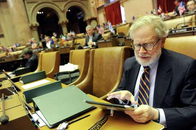 Assemblyman Richard Gottfried works with the new tablet in the Assembly Chamber on Wednesday, April 22, 2015, at the Capitol in Albany, N.Y. (Cindy Schultz / Times Union) Photo: Cindy Schultz / 00031574A