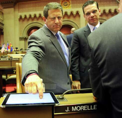 Majority Leader Joseph Morelle, left, works with the new tablet in the Assembly Chamber on Wednesday, April 22, 2015, at the Capitol in Albany, N.Y. Joining him is Assemblyman Angelo Santabarbara. (Cindy Schultz / Times Union) Photo: Cindy Schultz / 00031574A