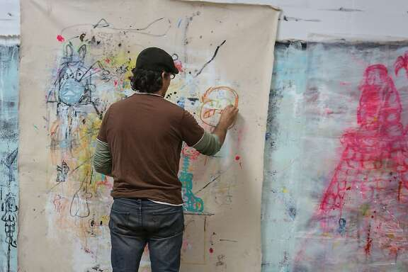 Juan Carlos Quintana works on his most current abstract work in his Oakland studio on Sunday, February 22, 2015 for an upcoming show that will take place in Manila, Philippines.
