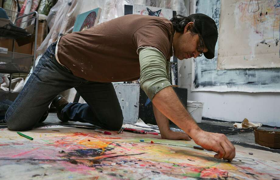 Juan Carlos Quintana works on his most current abstract work in his Oakland studio on Sunday, February 22, 2015 for an upcoming show that will take place in Manila, Philippines. Photo: Amy Osborne, The Chronicle