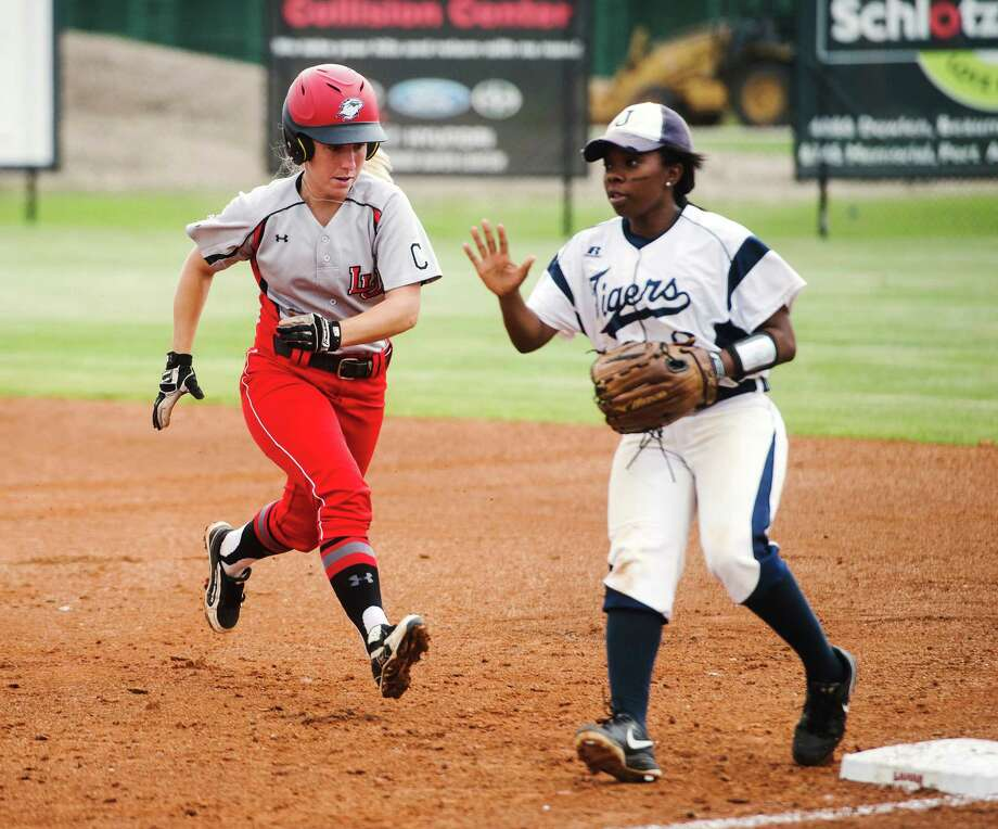 Lamar's Casey Cromwell, No. 11, heads back to first as Jackson State's Victoria Nelson, No. 8, looks for a catch on base Wednesday. The Lamar Lady Cardinals hosted the Jackson State Lady Tigers on Wednesday afternoon. Photo taken Wednesday 4/22/15 Jake Daniels/The Enterprise Photo: Jake Daniels / ©2015 The Beaumont Enterprise/Jake Daniels