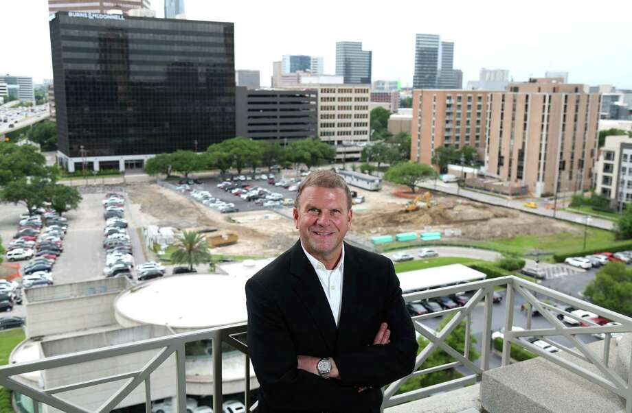 Tilman Fertitta poses for a portrait at Landry's headquarters, overlooking the site of his new development along the West Loop Wednesday, April 22, 2015, in Houston. Take a closer look at the Fertitta business empire. Photo: Jon Shapley, Houston Chronicle / © 2015 Houston Chronicle