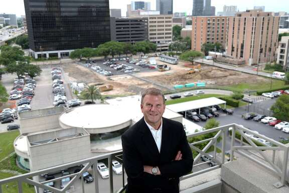 Tilman Fertitta poses for a portrait at Landry's headquarters, overlooking the site of his new development along the West Loop Wednesday, April 22, 2015, in Houston. ( Jon Shapley / Houston Chronicle )