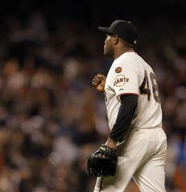 Santiago Casilla (46) pumps his fist after pinch hitter Adrian Gonzalez (23) grounded out to end the top of the ninth inning with two runners on base as the San Francisco Giants played the Los Angeles Dodgers at AT&T Park in San Francisco, Calif., on Wednesday, April 22, 2015. The Giants won 3-2 on a walk-off sacrifice fly by Joe Panik (12) in the ninth inning.