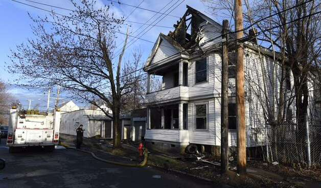 Authorities are investigating two fire that occurred early Thursday in Schenectady's Mont Pleasant neighborhood. This blaze on Sixth Avenue badly damaged a two-story home. (Skip Dickstein / Times Union)