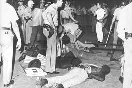 """From the News, April 26, 1971: """"Several arrested lie handcuffed at feet of officers...situation was brought in hand after scenes of policemen poured into the area."""""""