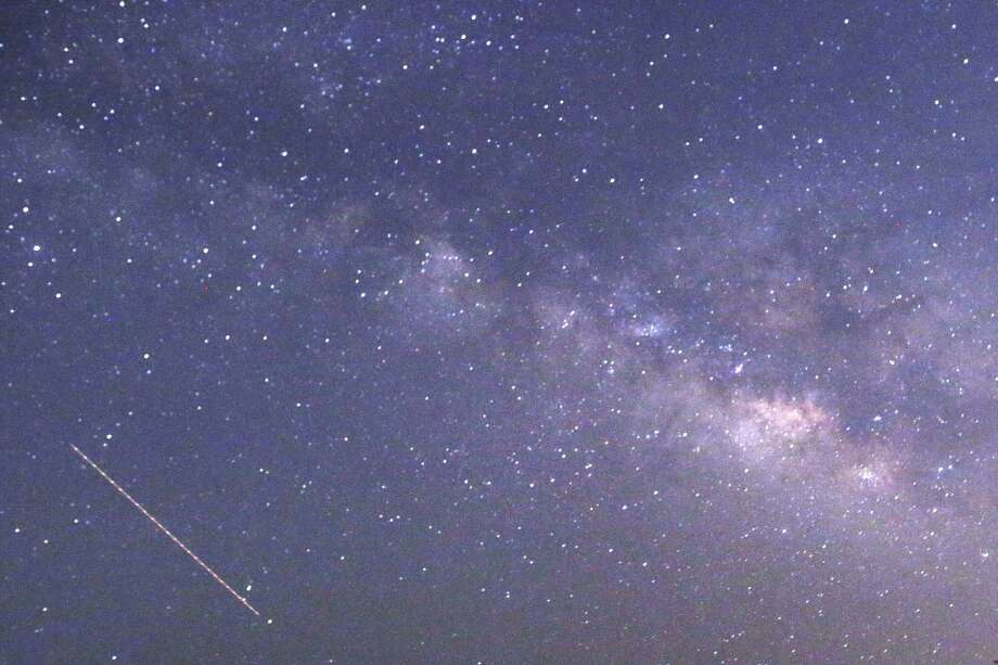 This long-exposure photograph taken on April 23, 2013 on Earth Day shows Lyrids meteors shower passing near the Milky Way in the clear night sky of Thanlyin, nearly 14 miles away from Yangon, Burma. Photo: YE AUNG THU, AFP/Getty Images