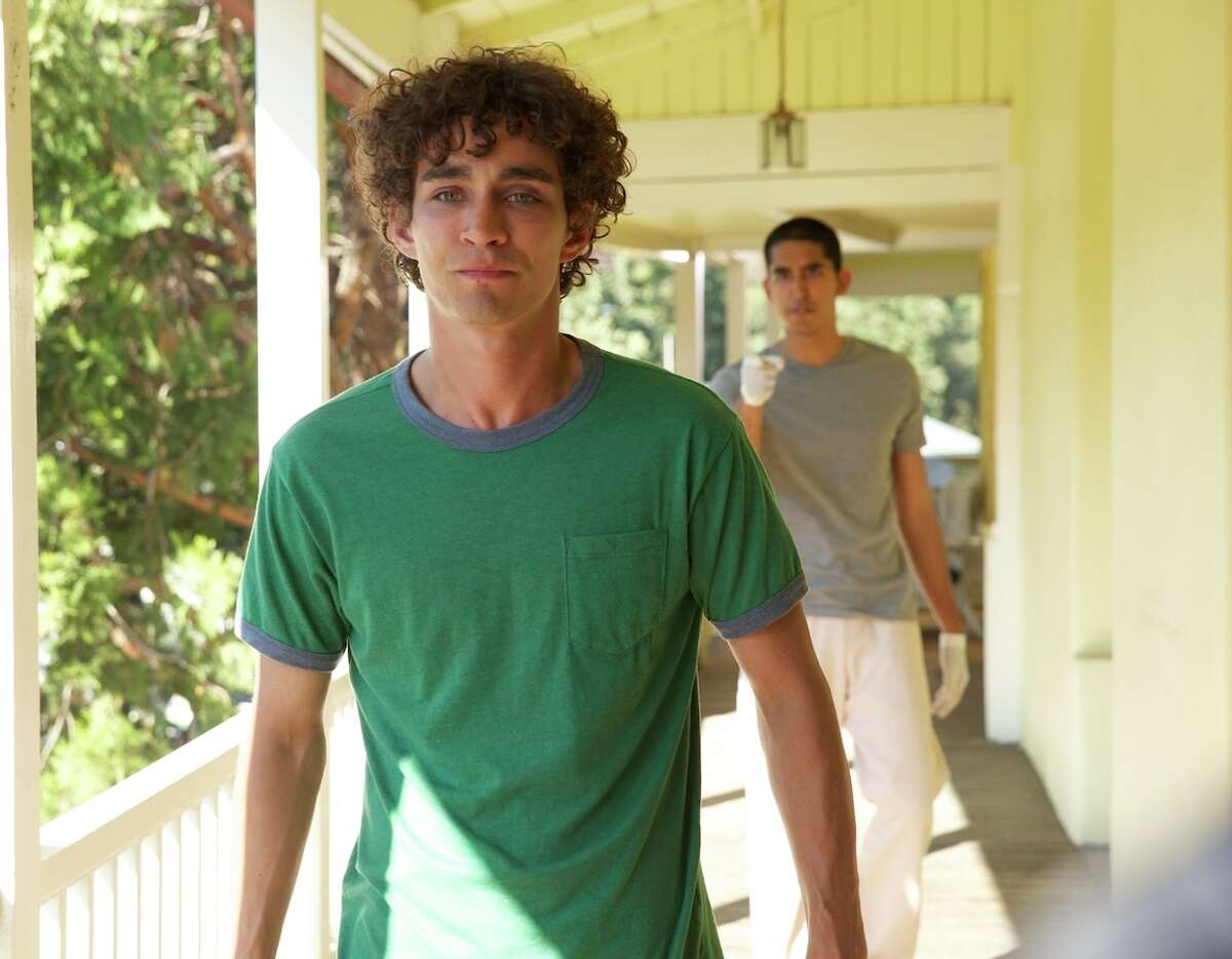 Robert Sheehan is Vincent, the teen with Tourette's syndrome, and Dev Patel is Alex, who screams when touched, making for an irritating twosome.