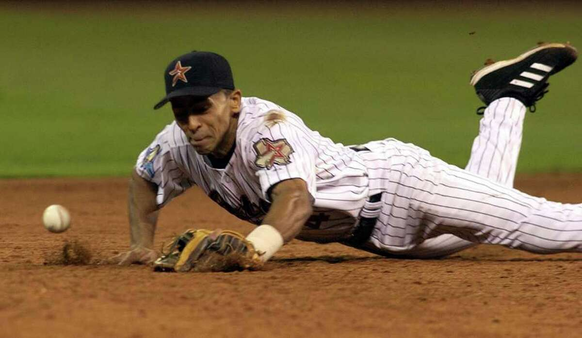 The Astros wasted little time in cutting ties with the former infielder Julio Lugo after reports of domestic violence surfaced.