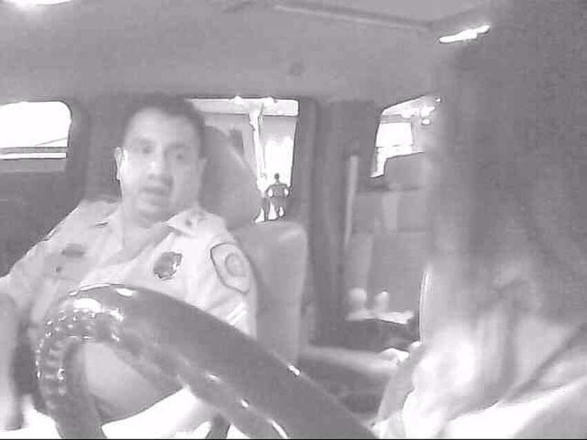Officer caught selling classified information to a drug trafficker?This screen shot is from a surveillance video of Houston Police Officer Noe Juarez meeting with a woman who was allegedly posing as a drug trafficker, but was really a government informant. A hidden camera in the pick-up truck recorded the conversation in which they spoke in Spanish about him allegedly checking some information for her in a classified police database. They are outside what was formerly the Chaparral night club, where Juarez was the chief of security.