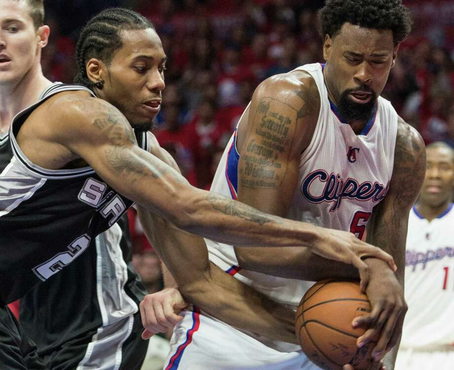 Los Angeles Clippers DeAndre Jordan battles for the ball against San Antonio Spurs Kawhi Leonard during the second half of Game 1 of a first-round NBA basketball playoff series in Los Angeles, Sunday, April 19, 2015. Photo: Ed Crisostomo /Associated Press / The Orange County Register