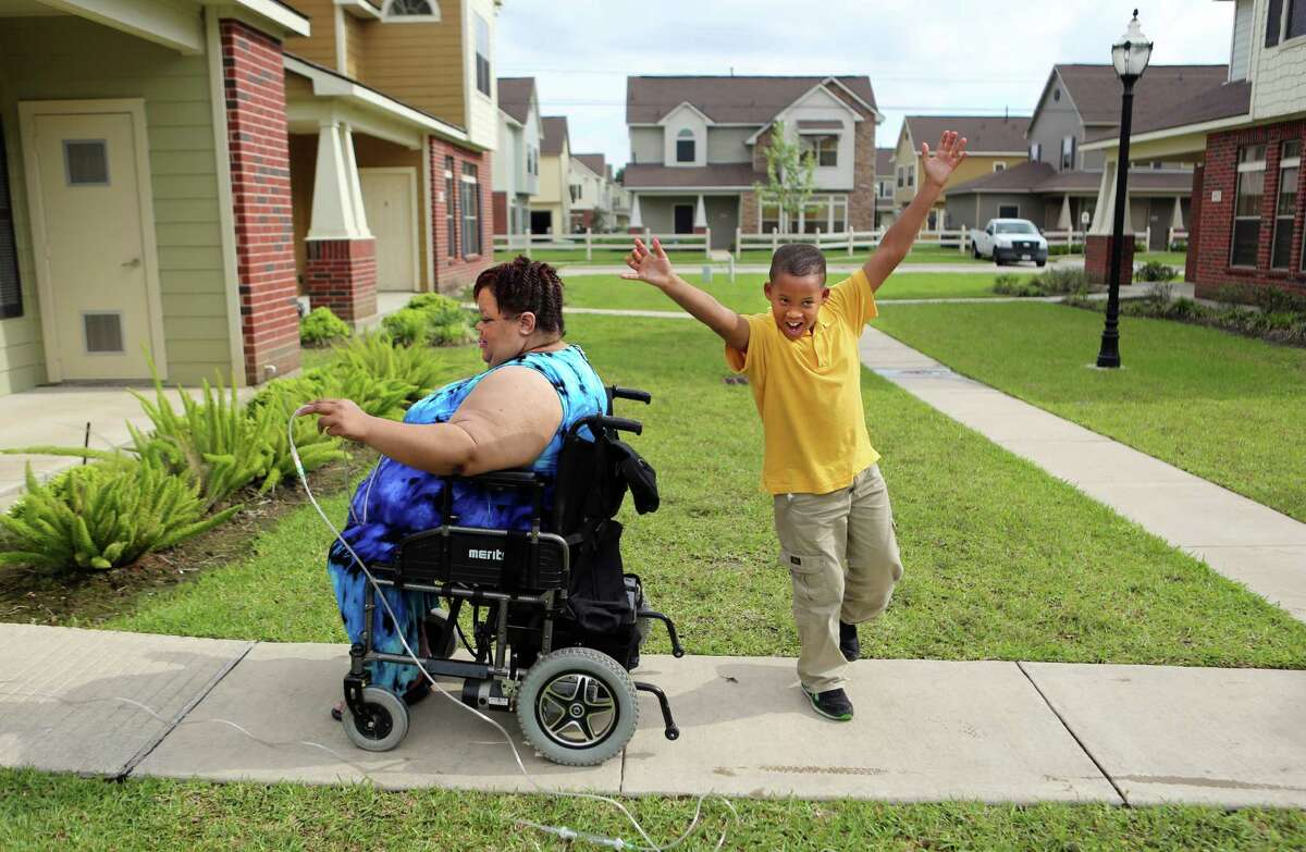 Chrystal Jenkins-Washington, 56, and grandson Jordan Melancon, 10, moved this this new home and transferred him to to Woodson Elementary School on Tuesday, April 14, 2015, in Houston. Jenkins-Washington, unhappy with her neighborhood school, Woodson, said she is considering trying to transfer Jordan to a new school. She said his grades have slipped and he gets picked on at Woodson.