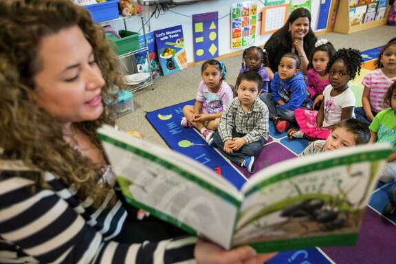 Pre-K teacher Vanessa de Simone Canseco reads to her class at Marshall Elementary School on Friday, April 17, 2015, in Spring.