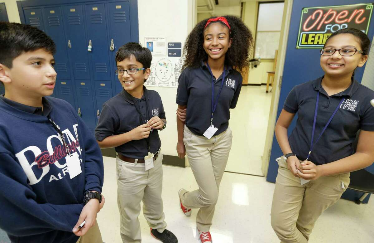 Sixth graders Matthew Jimenez, 12, left, Ronit Pillai, 11, Serena Hammond, 11, Anjni Patel, 11, talk about Baylor College of Medicine Academy at Ryan, 2610 Elgin, Thursday, April 16, 2015, in Houston.
