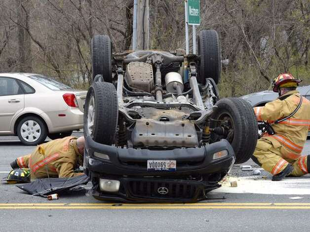 At least one person was taken from the scene on a stretcher after three-vehicle crash Thursday at the intersection of Western Avenue and Johnston Road in Guilderland. (Skip Dickstein / Times Union)