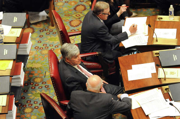 Senate Majority Leader Dean Skelos, center, on the Senate Floor on Wednesday, April 22, 2015, at the Capitol in Albany, N.Y. (Cindy Schultz / Times Union) Photo: Cindy Schultz, Albany Times Union / 00031571A