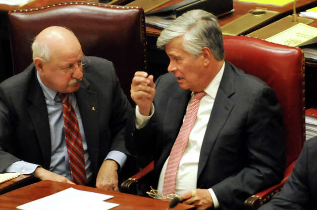 Senate Majority Leader Dean Skelos, right, speaks with Ken LaValle on the Senate Floor on Wednesday, April 22, 2015, at the Capitol in Albany, N.Y. (Cindy Schultz / Times Union) Photo: Cindy Schultz, Albany Times Union / 00031571A
