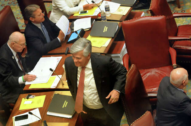 Senate Majority Leader Dean Skelos, center, leaves the Senate Chamber on Wednesday, April 22, 2015, at the Capitol in Albany, N.Y. (Cindy Schultz / Times Union) Photo: Cindy Schultz, Albany Times Union / 00031571A