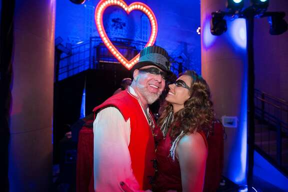 San Francisco art lovers and Burning Man fans Chris Bently and Camille Crowder held a gypsy masquerade party to celebrate their engagement and upcoming wedding in Scotland. The party featured aerial acrobats, stilt walkers and live music at the Bently Reserve on April 11, 2015.