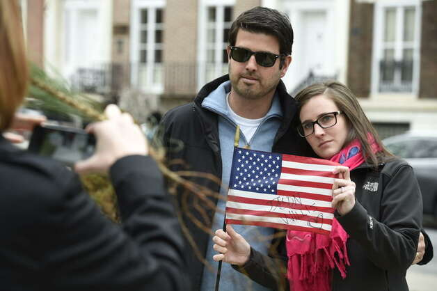 Nicole and Jeff Horowitz are photographed as they hold up a flag bearing their brother's name during a ceremony at the Crime Victims Ceremony of Remembrance at Albany's Academy Park on Thursday. The ceremony was part of the region's recognition during Crime Victims Week. (Skip Dickstein / Times Union)