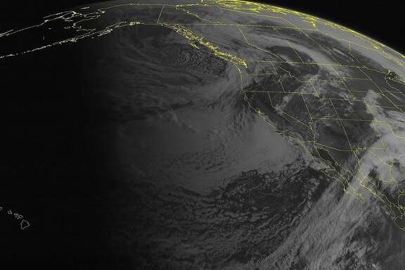 This NOAA satellite image taken Thursday, April 23, 2015 shows clouds are present across the Pacific Northwest, with rain and even some snow at higher elevations of the Cascades.