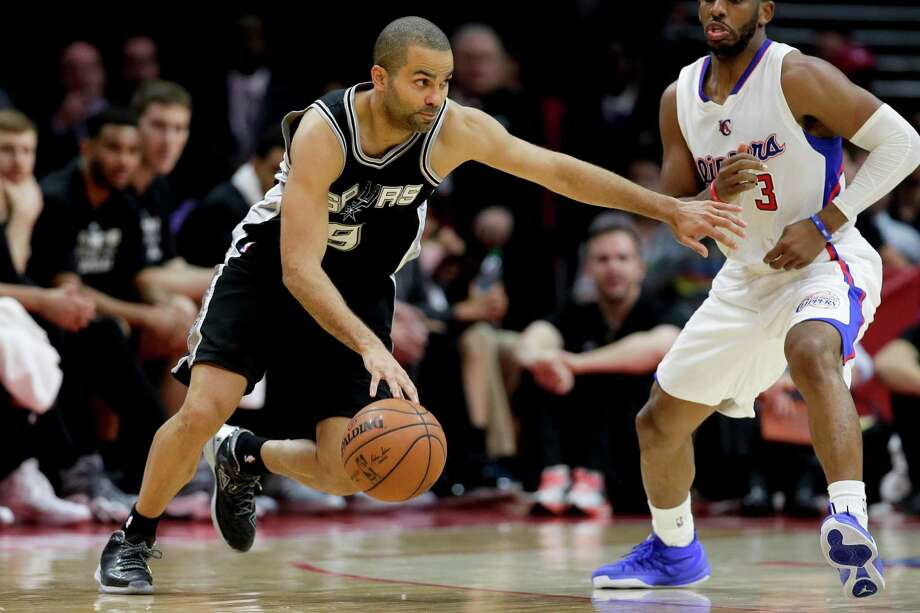 Spurs guard Tony Parker drives on Chris Paul during Game 2 of a first-round series against the Clippers in Los Angeles on April 23, 2015. The Spurs won 111-107 in overtime. Photo: Chris Carlson /Associated Press / AP