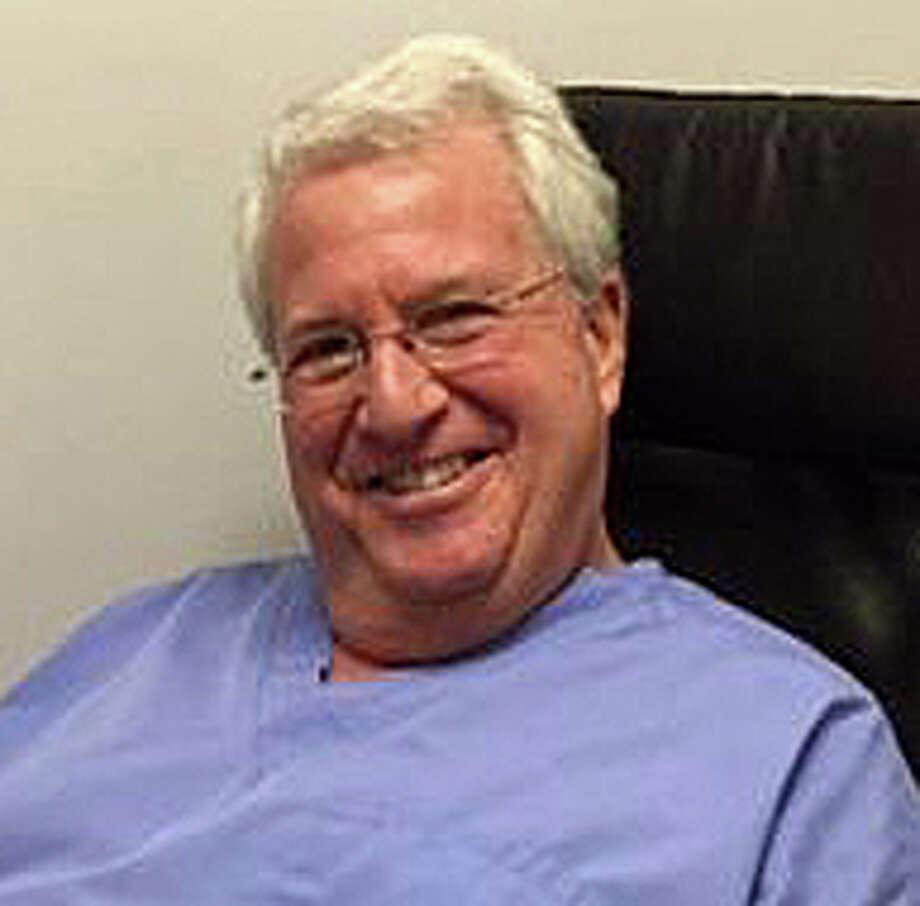 "Westport dentist Ira Novsam, writes columnist Dan Woog, will retire at the end of the month after 42 years. Of his patients, Novsam says: ""Hearing how important Iíve been to them is unbelievable ... Then we hug and cry together.î Photo: Contributed Photo / Westport News"