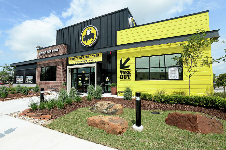 Beaumont's new Buffalo Wild Wings on Dowlen Road near Parkdale Mall will open Sunday. The spacious popular eatery features the signature banks of televisions and a patio dining/bar area. Mayor Becky Ames met with the owner and corporate officials for a ribbon cutting and preview of the interior Thursday. Photo taken Wednesday, April 22, 2015 Kim Brent/The Enterprise Photo: Kim Brent / Beaumont Enterprise