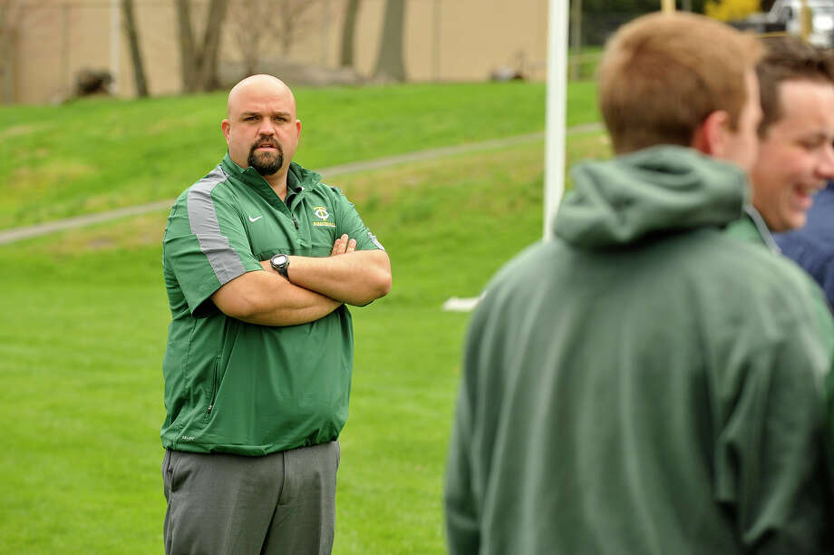 Trinity High School football coach Dan Panapada looks on during the ground breaking ceremony for the new sports complex at Trinity Catholic High School in Stamford, Conn., on Thursday, April 23, 2015. Photo: Jason Rearick / Stamford Advocate