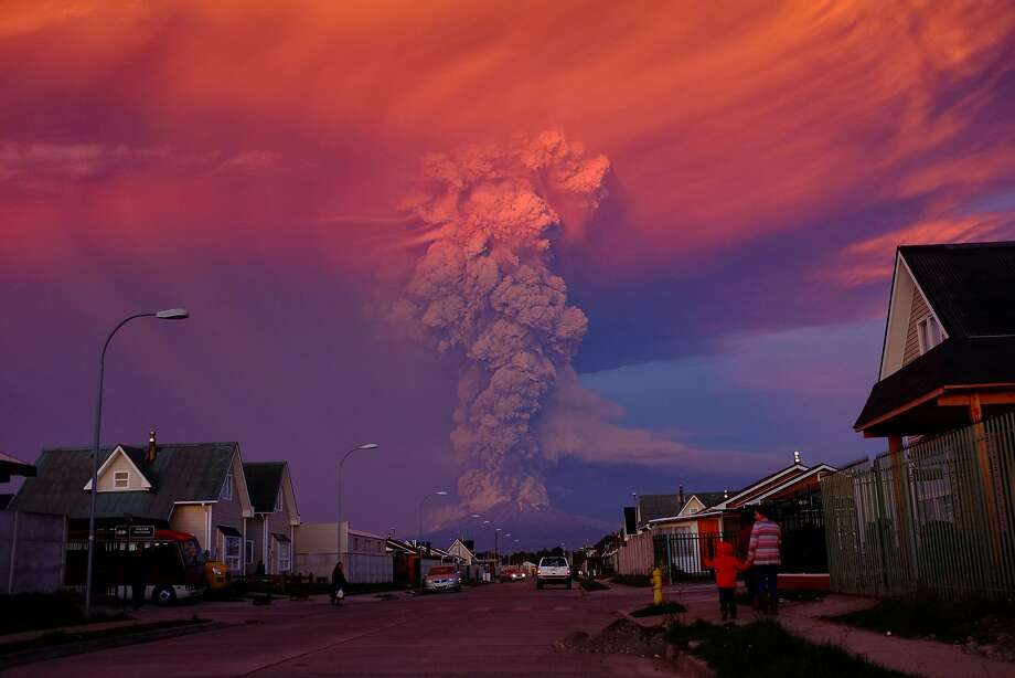 An ash plume rises from Chile's Calbuco volcano Wednesday. The volcano erupted again Thursday, leading the president to declare a state of emergency. Photo: Alex Vidal Brecas, McClatchy-Tribune News Service