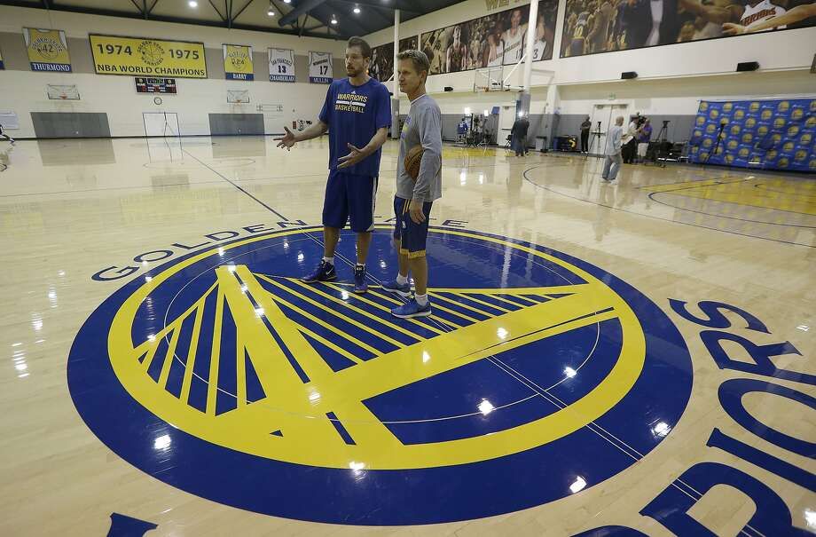 Golden State Warriors head coach Steve Kerr, right, talks with forward David Lee during NBA basketball practice at the team's training facility in Oakland, Calif., Friday, April 17, 2015. The Warriors host the New Orleans Pelicans in Game 1 in the first round of the NBA playoffs on Saturday. (AP Photo/Jeff Chiu) Photo: Jeff Chiu, Associated Press