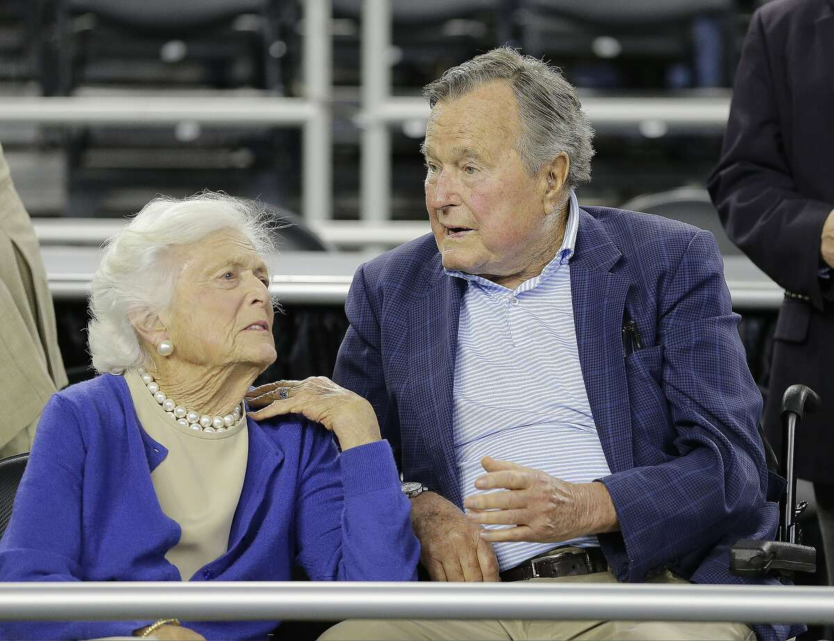 Former President George H.W. Bush and his wife Barbara Bush speak before the first half of a college basketball regional final game between Gonzaga and Duke, in the NCAA Tournament Sunday, March 29, 2015, in Houston.