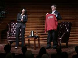 U.S. Secretary of Defense Ashton Carter is given a Stanford hoodie during his visit to Stanford University in Palo Alto on Thursday, April 23, 2015. The gift was a  symbolic gestureÐa bridge over the cultural divide between the federal government and the tech worldÐas the Obama Administration seeks a new level of partnership between the Defense Department and Silicon Valley.