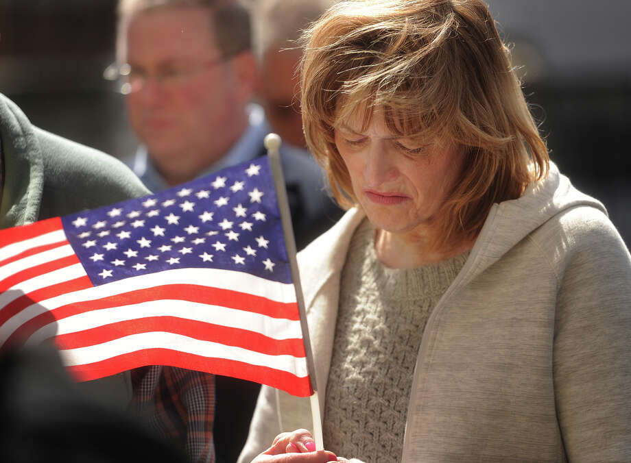 Lorraine Dennehy, of Milford, attends the L'Ambiance Plaza Memorial Ceremony outside City Hall in Bridgeport, Conn. on Thursday, April 23, 2015. The ceremony marked the 28th anniversary of the L'Ambiance building collapse, which killed 28 construction workers. Photo: Brian A. Pounds / Connecticut Post