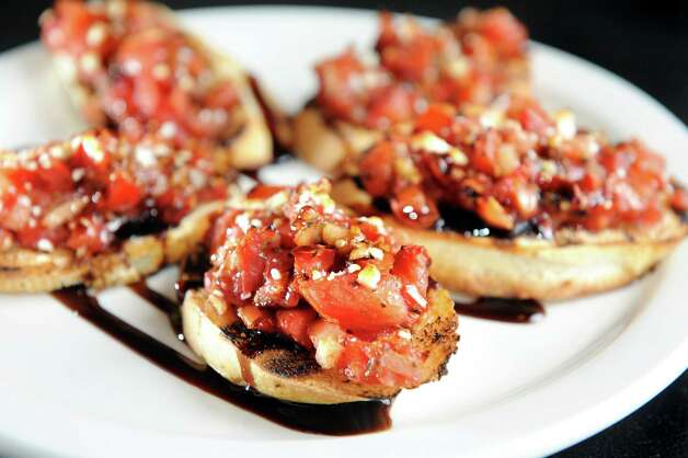Bruschetta with plum tomatoes, roasted red peppers, red onion, garlic, olive oil, balsamic and feta on Friday, April 17, 2015, at Spindles on Remsen in Cohoes, N.Y. (Cindy Schultz / Times Union) Photo: Cindy Schultz / 00031483A