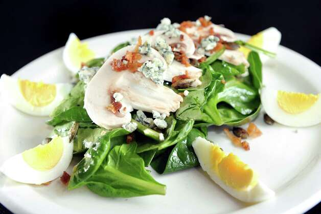 Spinach Salad with spinach, bacon, mushroom, egg, blue cheese, bacon vinaigrette and pumpkin seed on Friday, April 17, 2015, at Spindles on Remsen in Cohoes, N.Y. (Cindy Schultz / Times Union) Photo: Cindy Schultz / 00031483A