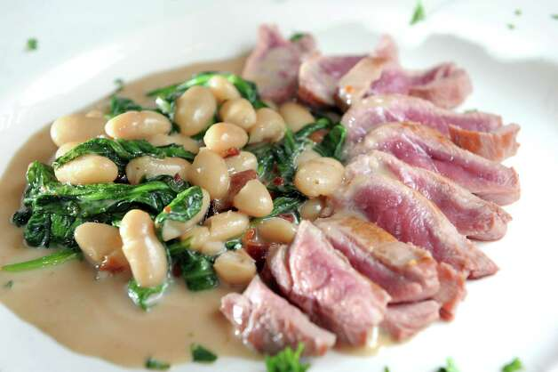Seared duck with duck breast, smoked bacon, spinach, white bean and bourbon cherry cream on Friday, April 17, 2015, at Spindles on Remsen in Cohoes, N.Y. (Cindy Schultz / Times Union) Photo: Cindy Schultz / 00031483A
