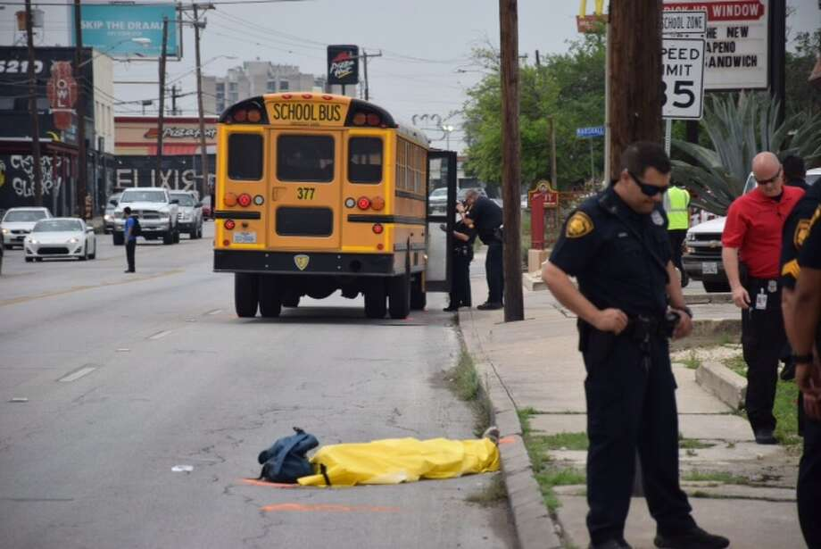 A man was struck and killed by a SAISD school bus while walking on a sidewalk in the 400 block of San Pedro Avenue on April 23, 2015. Photo: Mark D. Wilson/San Antonio Express-News